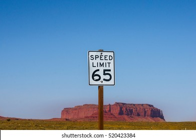 Speed Limit 65 - Sign with Monument Valley butte in background. US american road sign