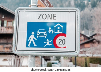 The speed limit zone of 20 km per hour begins at this point. This is seen on one of the streets in Champery, Switzerland.
