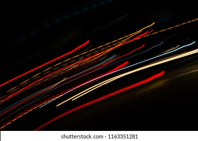 Speed motion abstract background in the dark night light lines with long exposure.