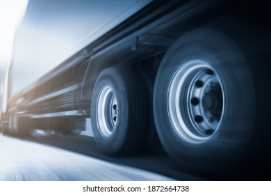 Speed motion blur of trailer truck driving on road. Business loistics. Cargo freight truck transportation.