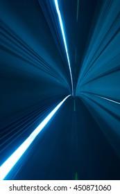 Speed motion blurred underground subway tunnel blue toned