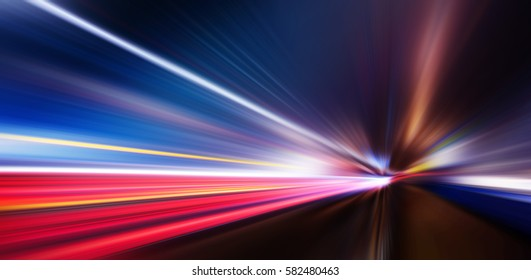 Speed motion,abstract background rays.Traffic car lights on road.