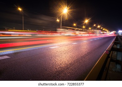 Speed motion,abstract background rays.Traffic car lights on road