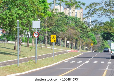 Speed radar with the maximum speed of 50 kilometers per hour next to a pedestrian crosswalk. Brazilian traffic speed monitoring at Afonso Pena avenue, Campo Grande MS, Brazil.