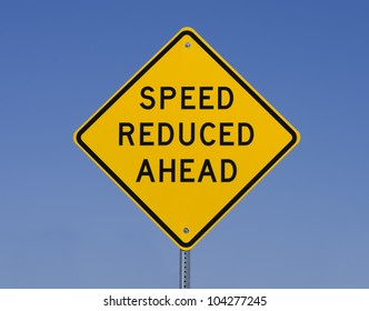 speed reduced ahead road sign with blue sky background