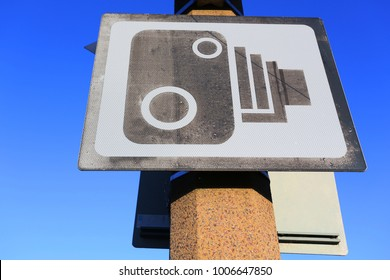 speed or security camera public signage against a blue sky