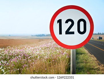 A speed sign of 120 Kilometer per hour, next to a road, overlooking a valley, in kwazulu natal, south africa