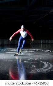 Speed skater departing from his race on an indoors ice rink