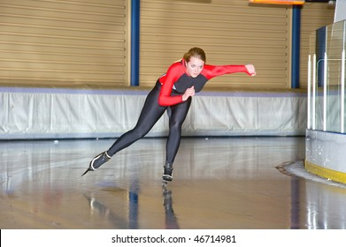 Speed skater during a trainings lap on an indoor ice rink