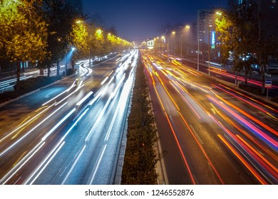 Speed Traffic - light trails on motorway highway at night, long exposure abstract urban background. Colorful light trace from night traffic in the city. Abstract motion blur city road, Beijing, China