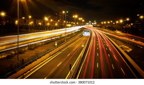 Speed Traffic, Madrid, Spain- light trails on motorway highway at night, long exposure abstract urban background.