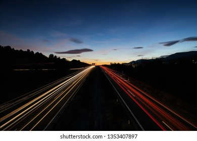 Speed Traffic at Sundown Time - light trails on motorway highway A92 in Spain after sunset, long exposure abstract background