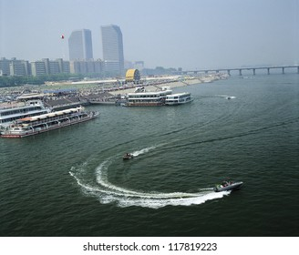 speedboats zooming by