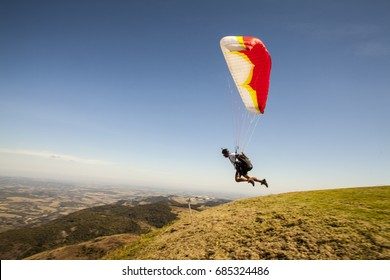 speedflying paraglider launching in sunny day, freedom concept.