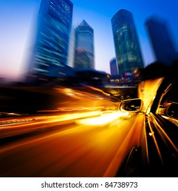 speeding car through the street of shanghai china in night.