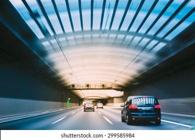 Speeding Cars Inside A Highway Urban Tunnel Motion Blur Background.