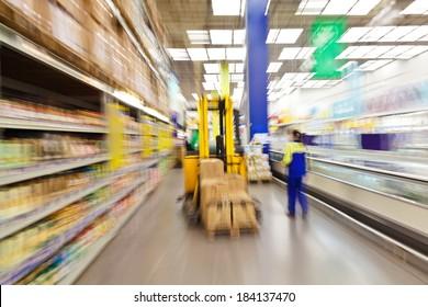 speeding forklift in supermarket, motion blur