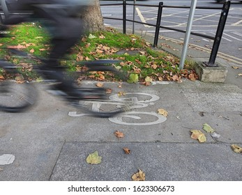 A speeding PURPOSELY to show fast motion) cyclist on a bicycle lane in Drumcondra, Dublin, Ireland