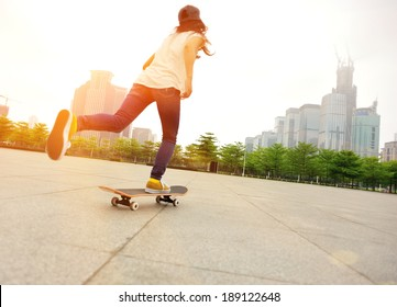 speeding skateboarding woman at city