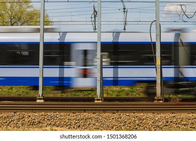 Speeding Train on suburban rails