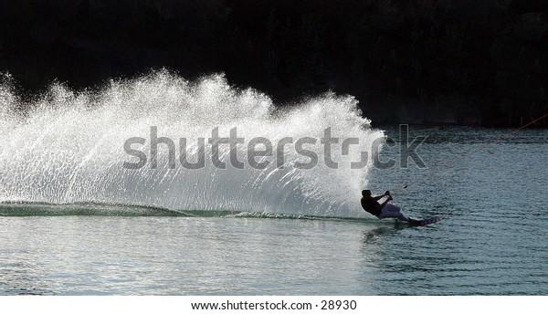Speeding waterskiier
