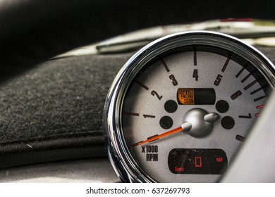 Speedometer close up. Service engine soon light. Dirty dusty speedometer
