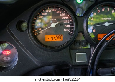 Speedometer of motorcycle on a open road from rider point of view. Motorcycle speedometer