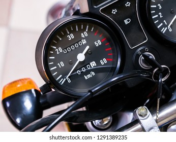 speedometer motorcycle with zero mileage. The bike is in the shop