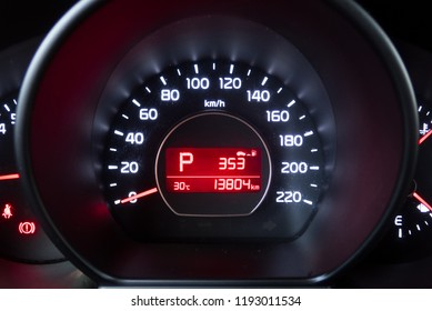 Speedometer and tachometer in a car. Car button controller with selective focus and crop fragment