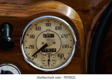 Speedometer in a wooden dashboard