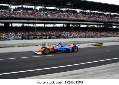 Speedway, IN, USA - May 26, 2019:  IndyCar driver Scott Dixon drives down pit road to make a pit stop during  the 2019 Indy 500 at Indianapolis Motor Speedway.