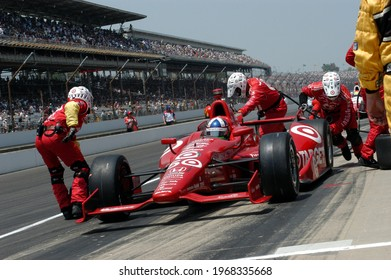 Speedway, IN, USA - May 27, 2012:  IndyCar driver Dario Franchitti makes a pit stop on his way to winning the 2012 Indy 500 at Indianapolis Motor Speedway.