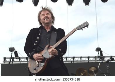 Speedway, IN/USA - May 22, 2015: Singer/guitarist Don Barnes performs with his band, 38 Special, at an outdoor concert in Indiana.