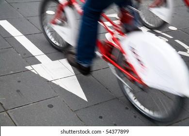 Speedy cyclist commuting on an urban cycleway.