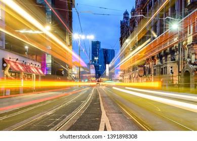 Speedy tram light trails at St Petersfield Manchester city center, UK.
