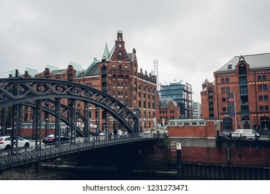 Speicherstadt (City of Warehouse) with steel bridge and the canal in cloudy day, Hamburg, Germany, 26th April 2018
