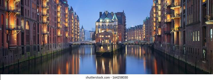 Speicherstadt Hamburg. Panoramic image of Hamburg- Speicherstadt during twilight blue hour.
