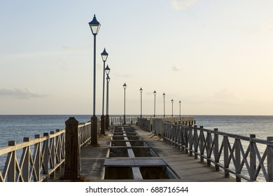 Speightstown Pier. Speightstown lies in the north of Barbados, only now being hit by tourism. In a traditionally poorer  part of the island the town's public jetty stands in disrepair.