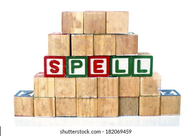 SPELL in alphabet word blocks isolated on a white background
