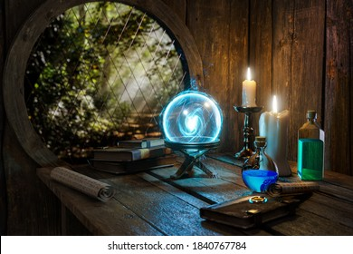 Spell book, Crystal mystic light ball, magic ring, magic potions bottles, burning candle and other various witchcraft accessories on the wizard table background. Alchemist  concept.
