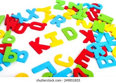 """spell letter of  """"kid"""" on white background"""