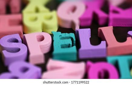 SPELL - words made from wooden blocks.