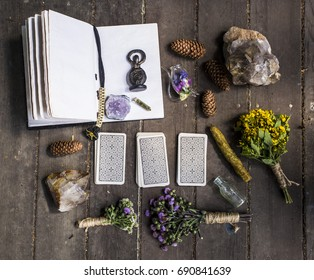 Spellbook, dry grass, wicca, magic, witchcraft, candles, crystals, taro