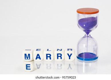 Spelled out Marry Me with an hour glass timer signifying time is running out.