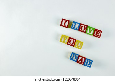 I Spelling I love you dad with blocks right alignment