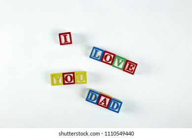 Spelling I love you dad with blocks