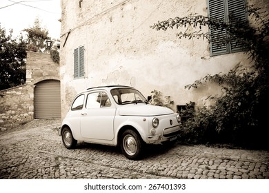 Spello, Italy : 2014, October 4 : A vintage Fiat 500 known as the Cinquecento in a cobbled street of the town of Spello in Umbria