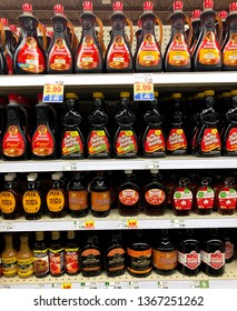 Spencer, Wisconsin, April, 12, 2019   Several bottles of Syrup on a modern day grocery store shelf