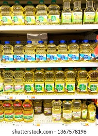 Spencer, Wisconsin, April, 3, 2019   Several bottles of cooking oil on a modern day grocery store shelf
