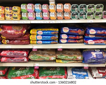 Spencer, Wisconsin, April, 4, 2019   Several brands of pet food on a store shelf